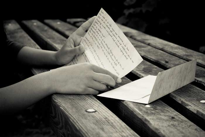 photo of hands holding a love letter