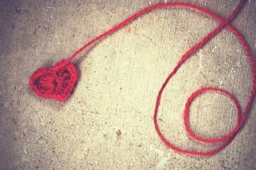 photo of red yarn ball wih heart at the end of skein