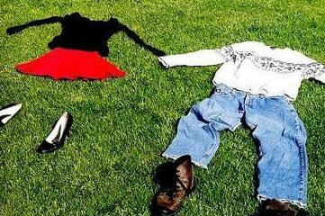 photo of clothes laid out on grass