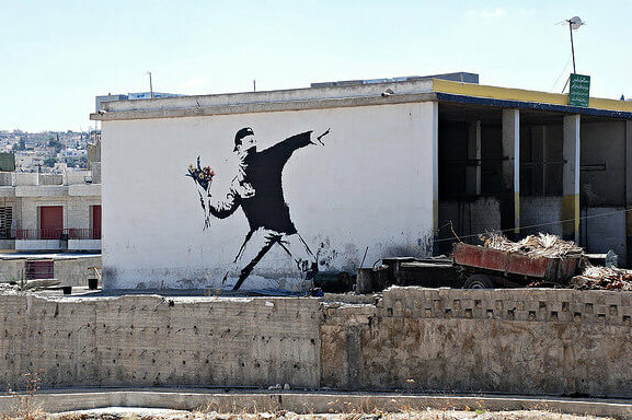photo of banksy street art seen in beit sahour, near bethlehem