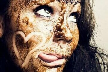 photo of woman with chocolate smeared all over her face