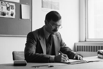 photo of man working at a desk