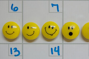 emoticon push pins on dry erase board