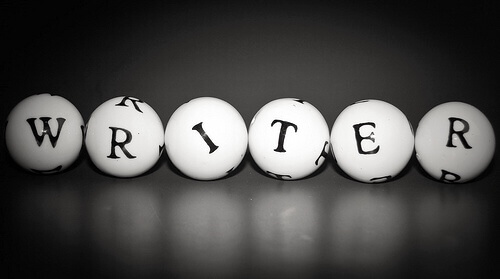 "Black & white image of letters on 5 small balls that spell out the word ""writer"""