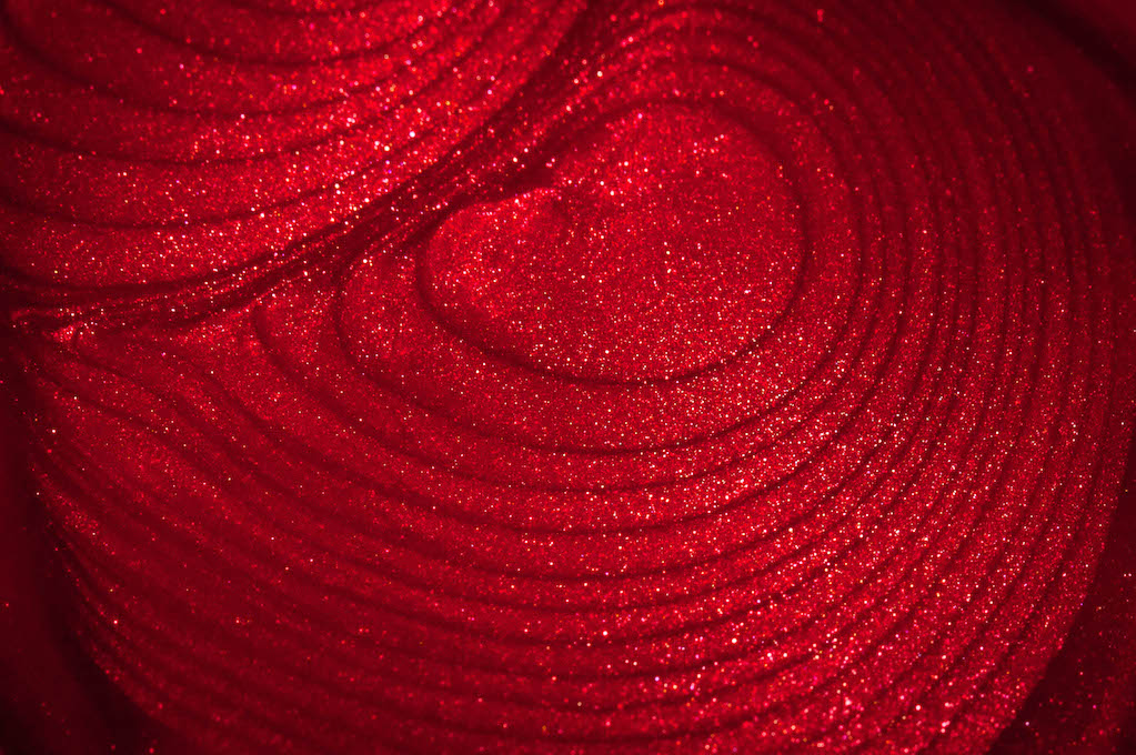 photo of sparkly red nail polish puddle