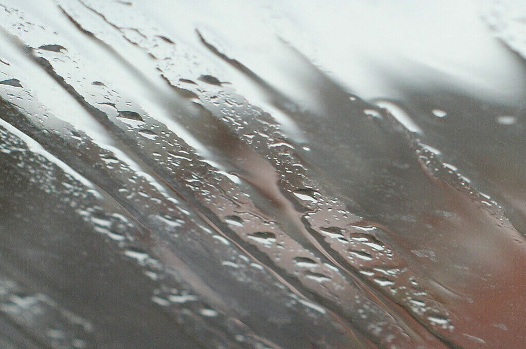 photo of rainwater droplets on glass