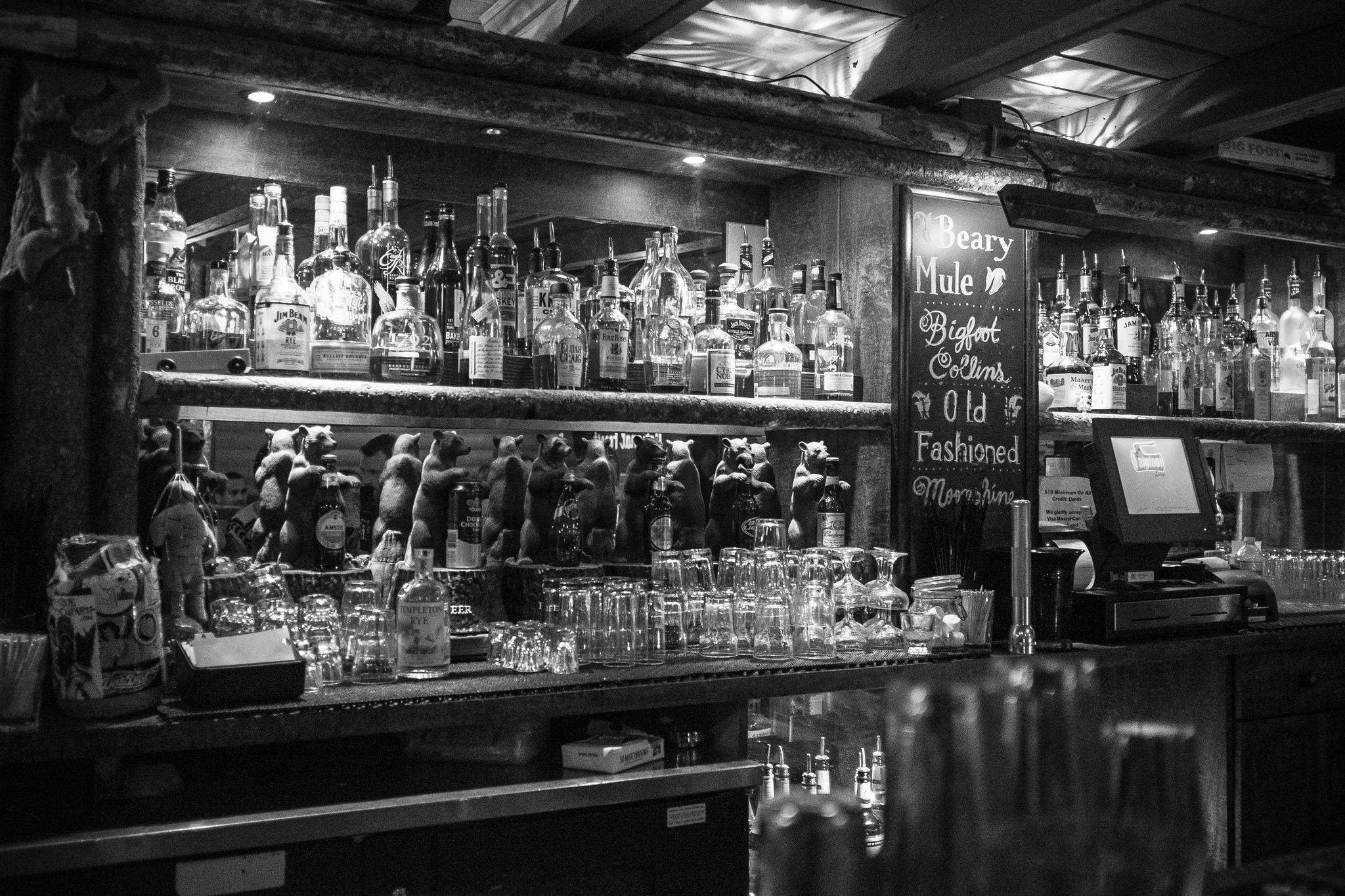 black & white photo of a stocked bar