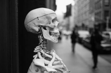 photo of skeleton in front of a store