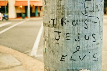 "photo of grafitti that says ""Trust Jesus & Elvis"""